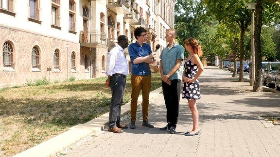 Dr. Karamba Diaby, Raimund Fichtenberger, Terence und dessen Frau (v.l.)